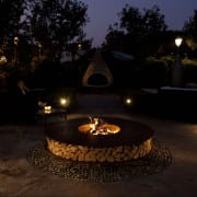 Discus outdoor wood burning fire pit