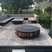 Discus outdoor fire pit